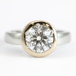Platinum Diamond Ring with a Rose Gold Halo Surround 1