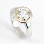 Platinum Diamond Ring with a Rose Gold Halo Surround 2